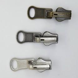 Cursores cremallera reversible inyectada malla 5 oro viejo, plata vieja y niquel.