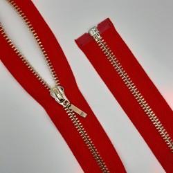 Cremallera roja separador de 50 cms y malla de color oro claro. Cremallera visible ideal chaquetas y abrigos.