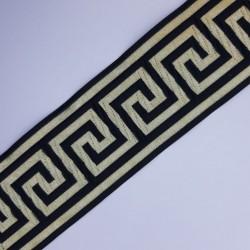 Cinta greca metalizada 5 cms dorada y negra. Ideal para prendas y complementos religiosos, disfraces, hogar, tapicería,..