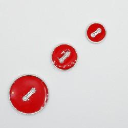 Botón rojo fino y esmaltado con filo plateado de 2 agujeros. Especiales para vestidos, blusas, camisas,..