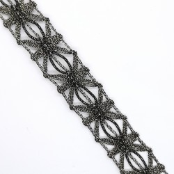 Galón metalizada 1,5 cms oro viejo oscuro. Pasamanería elegante y singular para remates y acabados en prendas y complementos.