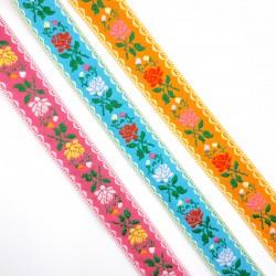 Galón tapacosturas de 2,5 cms con flores de colores. Cubrecosturas ideal para prendas y complementos.