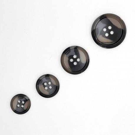 Botón poliéster camuflaje de 4 agujeros y aguas filo. Ideal para dar personalidad a tus prendas y complementos.