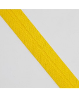 Cinta bies con ribete perfilado de color amarillo. Cinta adorno especial para remates y acabados en prendas y complementos.